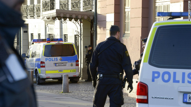 Policemen stand outside the Swedish Prime Minister's residence, Sagerska Palace, in Stockholm on November 9, 2012
