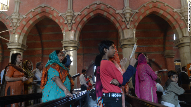 Pakistani Christians attend a prayer service in Lahore on Sunday. In the past month, Malala, 15, has gone from an intensive care unit in Pakistan, showing no signs of consciousness, to walking, writing, reading and smiling in a hospital in the UK.