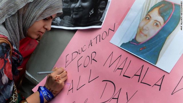A Pakistani student in Lahore writes a message on a placard on Saturday.