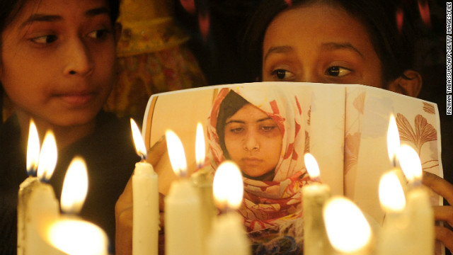 Pakistani supporters hold photographs of Malala as they stand alongside burning candles during a ceremony to mark Malala Day in Karachi on Saturday, November 10. The teen activist was shot in the head by the Taliban as she rode home from school in a van last month. She had defied the militant group by insisting on the right of girls to go to school. The attack has stirred outrage in Pakistan and around the world.
