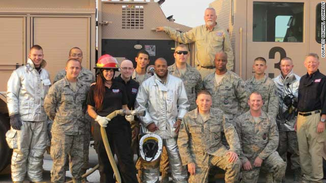 Crime author Michael Connelly (top row) visits with troops while on the Operation Thriller USO tour.