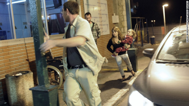 Israelis run for cover as a siren wails across the southern city of Ashkelon, on November 10, 2012, following earlier clashes.