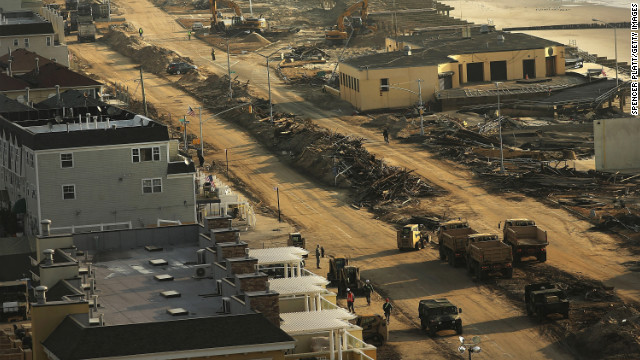 Clean-up continues on Saturday, November 10 among piles of debris where a large section of the iconic boardwalk was washed away in the heavily damaged Rockaways.