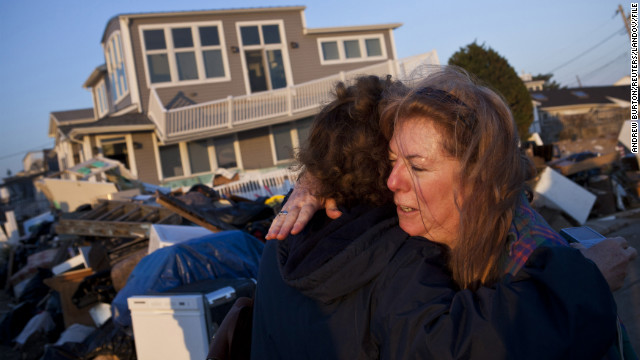 Evelyn Faherty hugs a friend on Sunday, November 11,<strong> </strong>while discussing the damage done to her home by Superstorm Sandy in the Breezy Point neighborhood of Queens, New York.