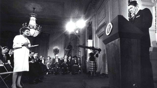 President Ronald Reagan is questioned by reporter Helen Thomas six days before the disclosure that profits from arms sales to Iran were diverted covertly to Contra rebels in Nicaragua. (March 19, 1987)