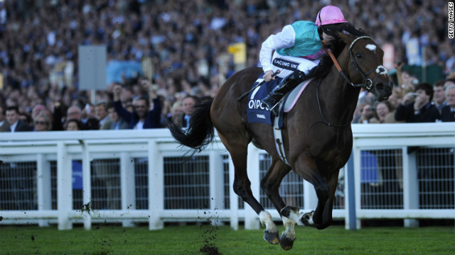 Frankel in action with jockey Tom Queally on board during his unbeaten 14-race streak which helped make him into a cult hero.