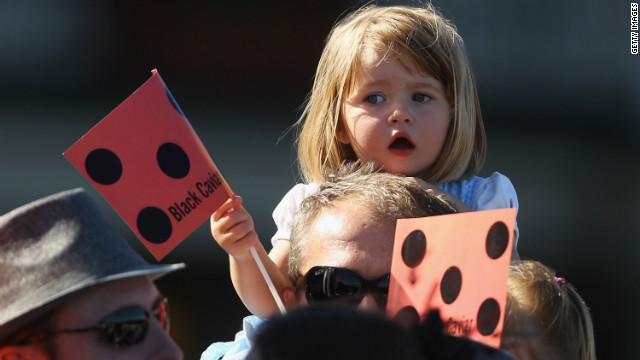A young racegoer shows her support for Australian horse Black Caviar. The owners chose the name because they thought it appeared sophisticated and stylish.