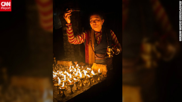 "<a href='http://ireport.cnn.com/people/TravelinRav'>Stephen Ravndal</a> of Boston, Massachusetts, took this photo of a woman lighting a candle to mark the beginning of Diwali whilst wandering the backstreets of Boudnath, Nepal. ""The woman's attention to detail and devotion are plainly obvious and the lights, which are such an integral part of the festival, really capture a warm and serene mood,"" he says.<br/><br/>"