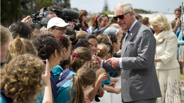 Britain's Prince Charles and his wife Camilla greet well-wishers in Auckland on Monday.