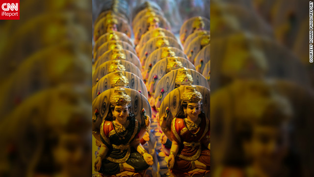 "This picture was captured by iReporter Rohan Pavgi and displays miniature-statues of the Goddess Lakshmi for sale in a market in Pune, India. He says the neat manner in which the statues are aligned emphasizes an important part of Hindu beliefs and tradition.<br/><br/>""[Lakshmi] is worshiped by those who wish to acquire or to preserve wealth. It is believed that (wealth) goes only to those houses which are clean and where the people are hardworking,"" he says. ""She does not visit the places which are dirty or where the people are lazy."""