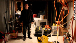 Jeff Spangler works in his basement after losing thousands of dollars worth of property from Superstorm Sandy.