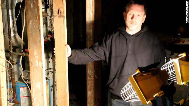 Jersey City resident Jeff Spangler works by floodlight in his basement, which was destroyed by Superstorm Sandy.