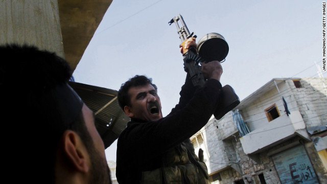 A Syrian rebel commander of the Halab al-Shabah battalion motivates fighters during clashes with regime forces in Al-Amariya district of Aleppo on Tuesday, November 13.