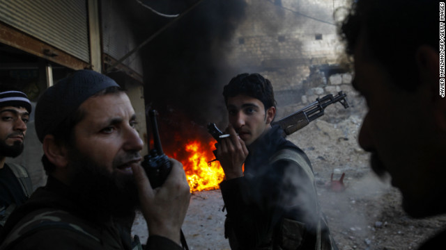 Syrian rebels take position in Aleppo on Tuesday.