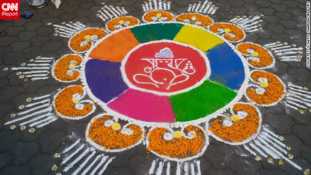 "A rangoli artwork, as created and captured by iReporter Kshitij Sharma, adorns a sidewalk in Pune, India. ""I think this festival reminds us to stay away from bad things and to promote communal harmony,"" he says. ""The main highlight is of course the lights, at night whole cities and towns look lovely because of the lights."""