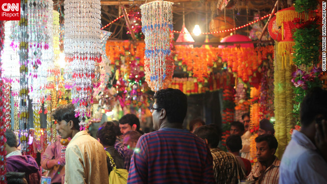 "Manish Kanojia took this photograph whilst shopping at the Sadar Bazar in Delhi, one of the busiest wholesale markets in India. According to Kanojia it is famous for Diwali shopping. He says the day he captured the image ""the markets were crowded [and] people were happily shopping around for gifts and decoration stuff."""
