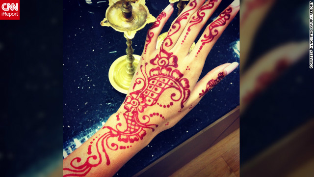 "Artist and fashion designer <a href='http://ireport.cnn.com/people/Hyacinth3'>Hyacinthe Kaur</a> decided to adorn her hands with henna art when she was shopping for Diwali in a busy bazaar in Klang, Malaysia. ""There were a few henna artists around, but this particular applier seemed to put a lot of heart, thought and dedicated effort into her work,"" she says. ""After the design was complete, I felt so overwhelmed and happy with the results -- it put a big smirk on my face."""