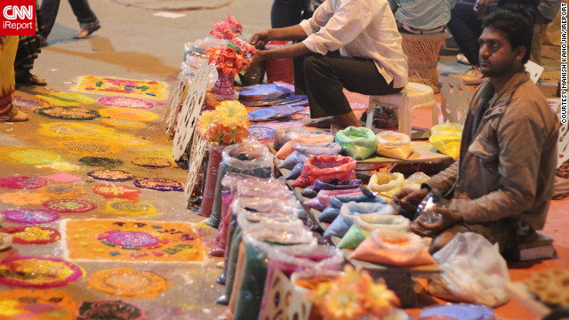 "This brightly colored photo was taken by Manish Kanojia in the ""happening"" Sector 18 of the Noida district in New Delhi. The colored sand on sale is for making Rangolis, decorative floor designs made to welcome guests and encourage the goddess Lakshmi inside during Diwali. ""Most people buy the sand and make their own, or they buy readymade stencils,"" Kanojia says. <br/><br/>"