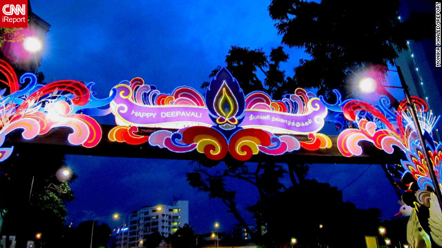"A vivid neon sign celebrating Diwali hangs above Singapore's Little India district. The image was captured by iReporter, <a href='http://ireport.cnn.com/people/MonikaKH'>Monika Khaled</a>, an Austrian living and working in the populous Asian city state. ""Deepavali in Singapore is a great event visited by visitors and locals alike and not just Indians,"" she says"