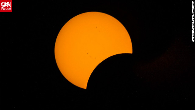 "This Pac-Man shaped image of the sun was taken by <a href='http://ireport.cnn.com/docs/DOC-881254' target='_blank'>Chad Loel Rademan</a> onboard a cruise ship in the Coral Sea about 550 miles northeast of Brisbane, Australia. ""At 41 I was the baby on the ship but it was a great atmosphere, the upper deck was crammed with people and when the sun disappeared the sky looked a bit creepy but beautiful,"" he said."