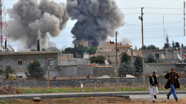 A picture taken from the town of Ceylanpinar after a Syrian aircraft bombed the border town of Ras al-Ain, on November 13.