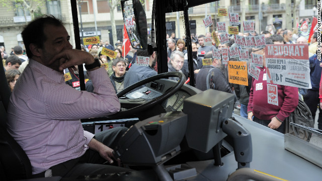 Demonstrators block a bus in Barcelona.