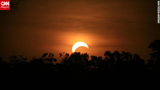 "<a href='http://ireport.cnn.com/people/Stitchum'>Sandra Otto</a> took this photo from the side of the road in the northern suburbs of Darwin, Australia, after forgetting about the eclipse until it was about to happen. ""I quickly got my camera and my bigger lens and jumped into my utility,"" she says. "" I wish I was better prepared but found it to be a truly amazing experience, spectacular."""