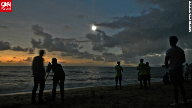 "iReporter <a href='http://ireport.cnn.com/docs/DOC-881111'>David Brungger</a> was one of many people to witness the eclipse at Palm Cove in the north of Queensland. ""When everything finally went almost totally dark, some people were clapping, some people were cheering with joy, and we all took our eclipse glasses off to enjoy some of the most exciting and beautiful seconds of my life. Too bad it only lasted roughly one minute,"" he says."