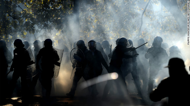 Demonstrators fight riot policemen during a protest against austerity measures in Rome.