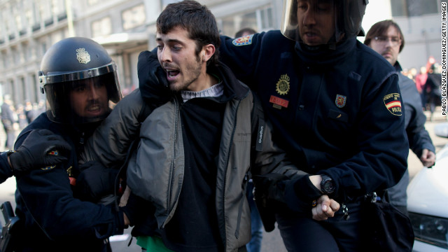 Riot police arrest a protester at Gran Via in Madrid, Spain.