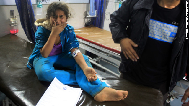 A wounded Palestinian girl cries at the Al-Shifa Hospital in Gaza City.
