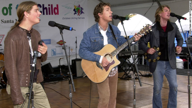 "Isaac, Taylor and Zac Hanson of Hanson are shown here performing in 2001. The brothers became superstars with their 1997 album ""Middle of Nowhere"" thanks to a little earworm called ""MMMBop."""