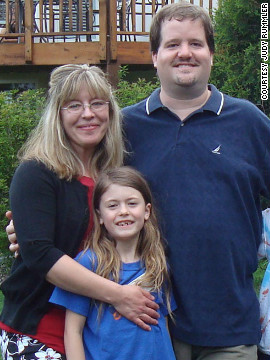 Steve Rummler with his fiancee, Lexi Reed Holtum, and her daughter, Isabella, in 2011.
