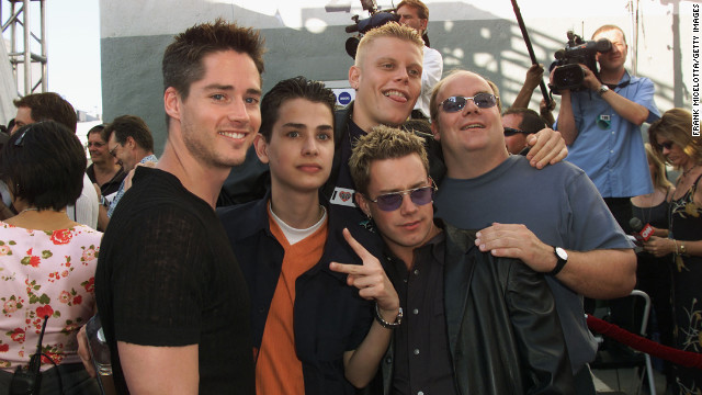 The made-for-TV boy band 2gether debuted on MTV in 2000. Shown here at the 2000 MTV Movie Awards, the guys attracted attention with songs like &quot;U + Me = Us (Calculus)&quot; and &quot;Say It (Don't Spray It).&quot; &quot;2ge+her: The Series&quot; followed the original TV movie, but ended in 2001 when Michael Cuccione, who played Jason 'Q.T.' McKnight, died of cancer. In &lt;a href='http://marquee.blogs.cnn.com/2011/11/15/mtvs-fake-boy-band-2gether-plots-comeback/' target='_blank'&gt;November 2011&lt;/a&gt;, Alex Solowitz, Evan Farmer, Noah Bastian and Kevin Farley said they were looking to reunite the band.