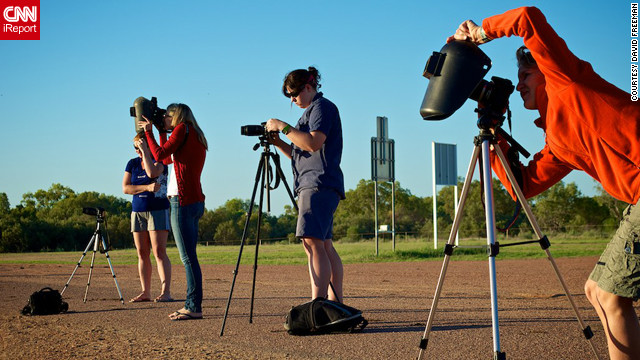 "<a href='http://www.flickr.com/photos/8547591@N08/' target='_blank'>David Freeman</a> of Longreach in outback Queensland sent in this image of photographers prepping for the big moment. ""Even if we didn't get totality the light was really interesting,"" he says. ""Coming so close after sunrise we had the typical outback orange and red sunrise and then went into an almost surreal subdued light. Not the same colors as a normal sunrise but definitely not normal daylight either."""