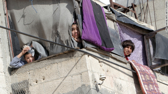 Palestinians watch a funeral Thursday, November 15, in southern Gaza. 