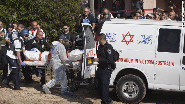 Rescue workers evacuate a body Thursday in the Israeli town of Kiryat Malakhi after a rocket launched from Gaza hit an apartment building.