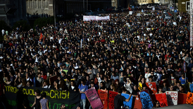 Demonstrators in Rome march Wednesday against austerity measures. Protesters say government spending cuts will compromise livelihoods and increase unemployment.