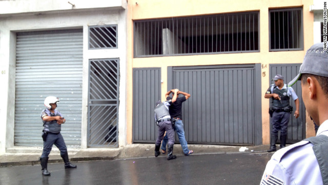 Young men in Brasilandia are frisked as police hunt drug dealers, car thieves and gang members. The raids are part of a clampdown on the First Command of the Capital gang (or PCC) which has killed about 100 police this year.