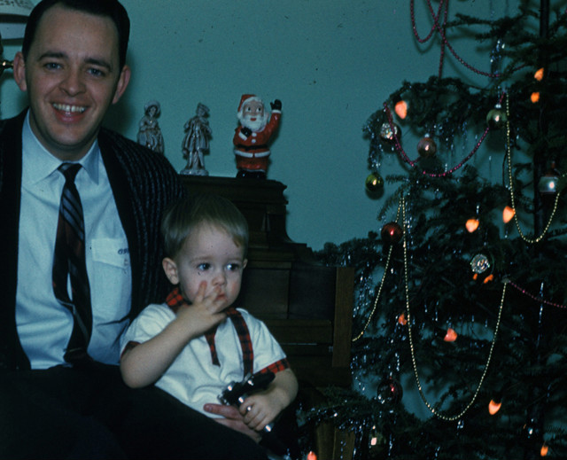 Andy, then about 4, with his father, the Rev. Charles Stanley, during Christmas.