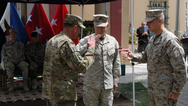 Petraeus, left, salutes his replacement as leader of the Afghanistan war, Gen. John Allen, right, and Gen. James Mattis during a change of command ceremony in Kabul, July 2011.