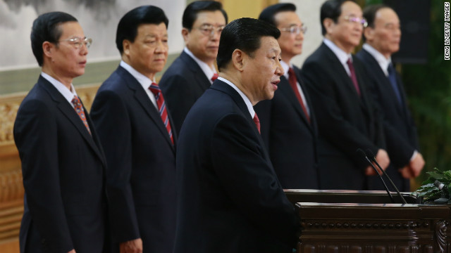 Xi Jinping delivers a speech as the rest of the new Politburo Standing Committee looks on.