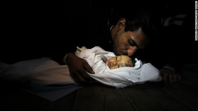 Palestinian relatives mourn over the body of Hanen Tafish, a 10-month-old girl, at the morgue of the al-Shifa hospital in Gaza City on Thursday, November 15, after she died following an Israeli air strike in the Zeitun neighbourhood.