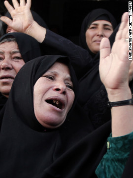 Palestinian relatives of Hisham Ghalban mourn over his body in Khan Younis in the southern Gaza Strip, on November 15.