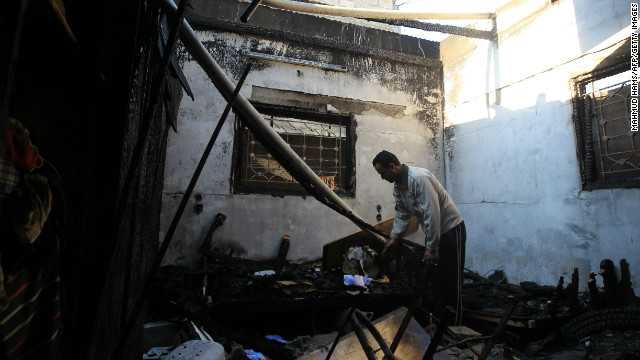 A Palestinian man inspects his damaged house following an Israeli airstrike early Thursday in Gaza City.