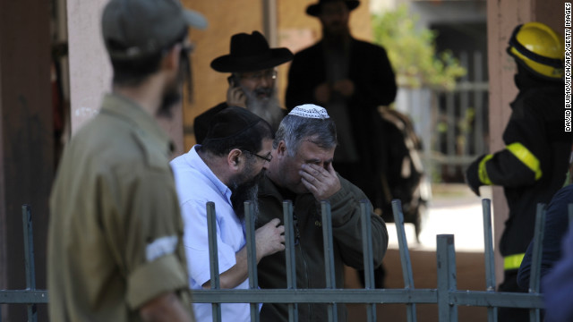 An Israeli reacts after a rocket launched from Gaza hits a building Thursday, November 15, in Kiryat Malakhi.