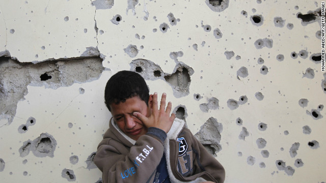 Palestinian Fares Sadallah, 11, cries outside his home after an Israeli airstrike Friday in northern Gaza.
