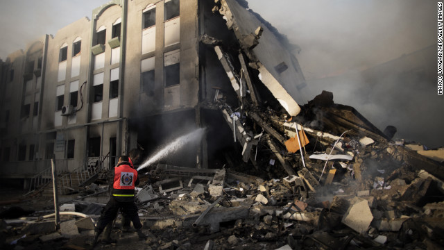 Palestinian firefighters try to extinguish a blaze Friday at the Ministry of Interior in Gaza City following an Israeli air raid.