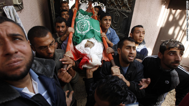 Palestinian mourners carry the body of Audi Naser during his funeral in Gaza on Friday.