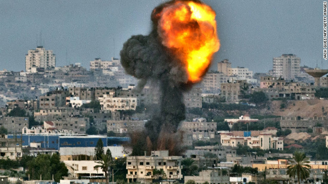 Smokes billows from a target of an Israeli airstrike Friday in Gaza near the border with Israel.